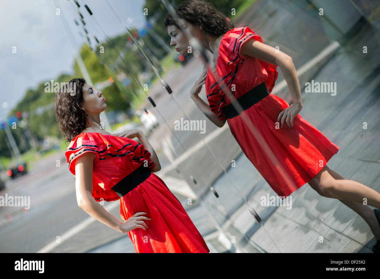 Woman in soaking wet dress adjust her outlook - Stock Image