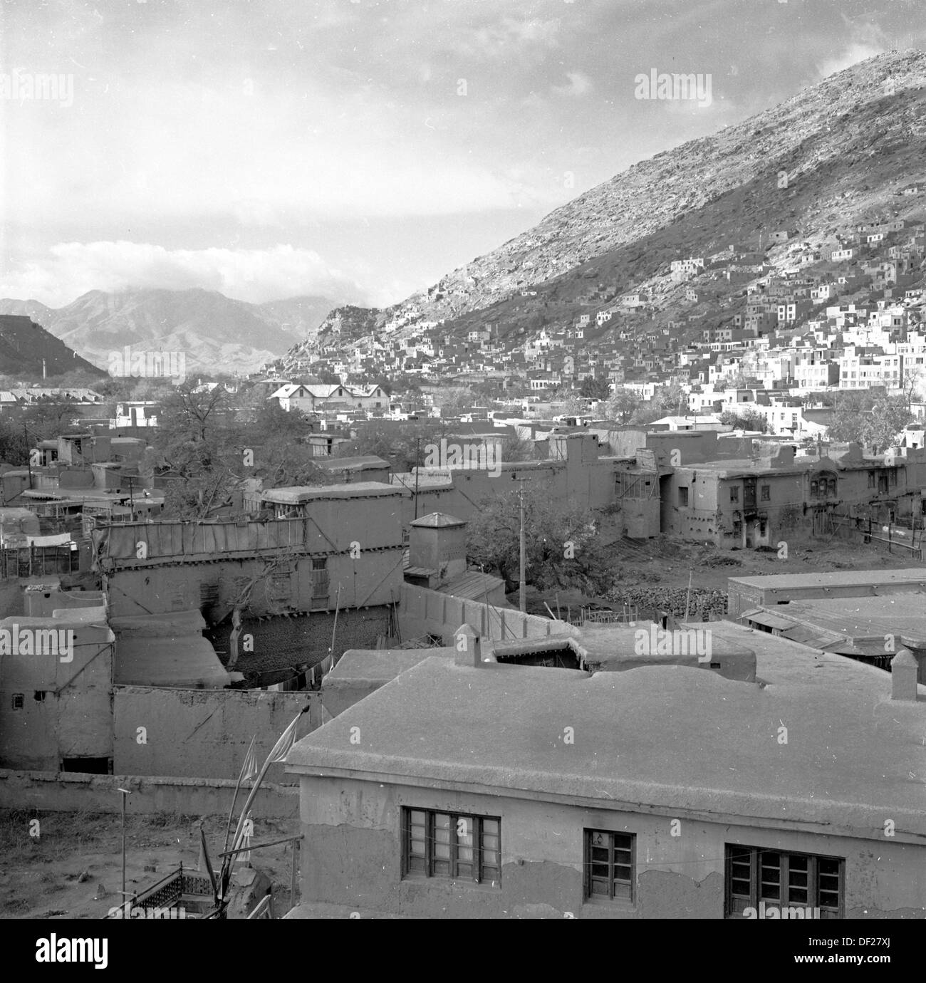 Historical picture from 1950s by J Allan Cash of buildings and mountains near the capital city of Kabul, Afghanistan - Stock Image