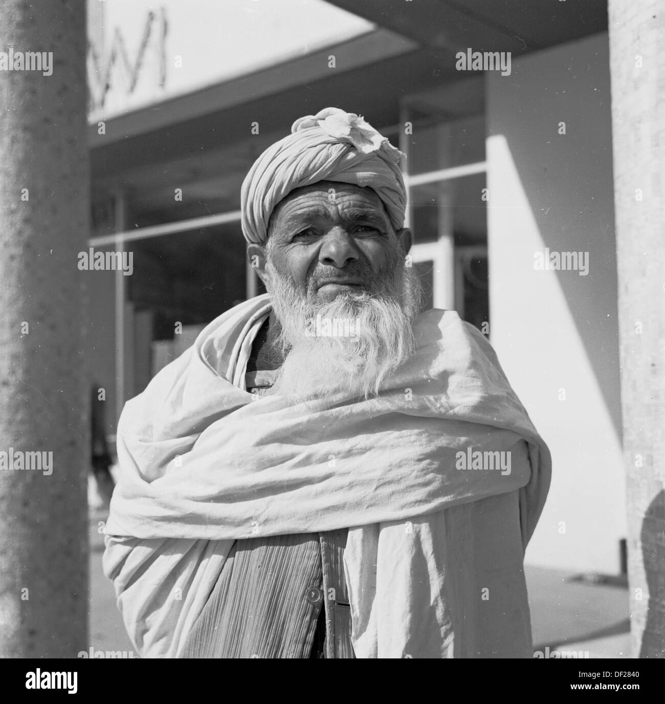 Historical picture from1950s by J Allan Cash of an elderly bearded Afghan male in Kabul, Afghanistan with his robes and turban. - Stock Image