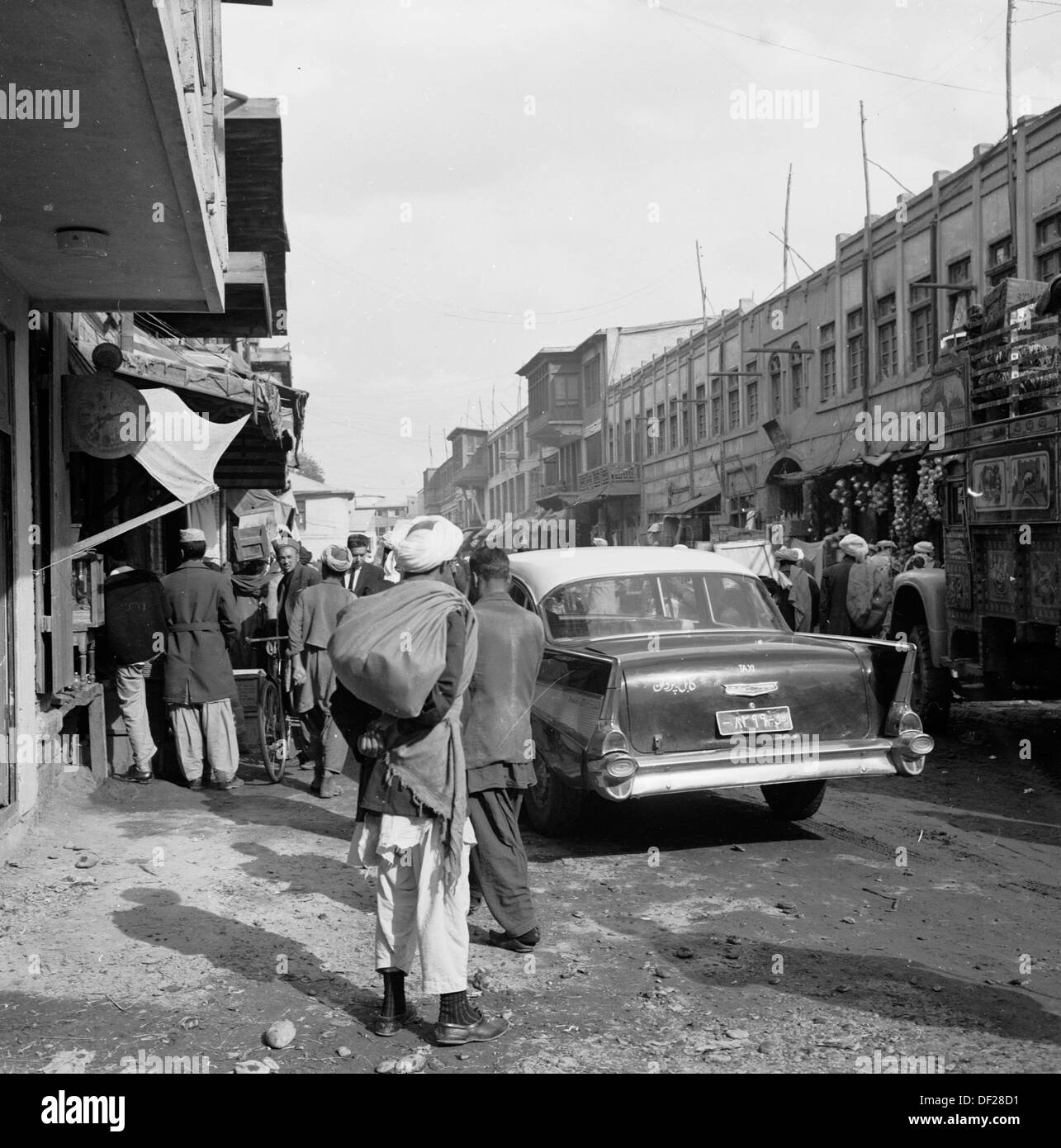 Historical picture from1950s by J Allan Cash showing a busy street in the capital city of Kabul, Afghanistan. - Stock Image