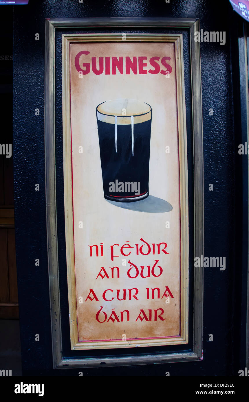Irish pub with Guinness ad poster in both Gaelic and English, Kilkenny, Ireland Stock Photo