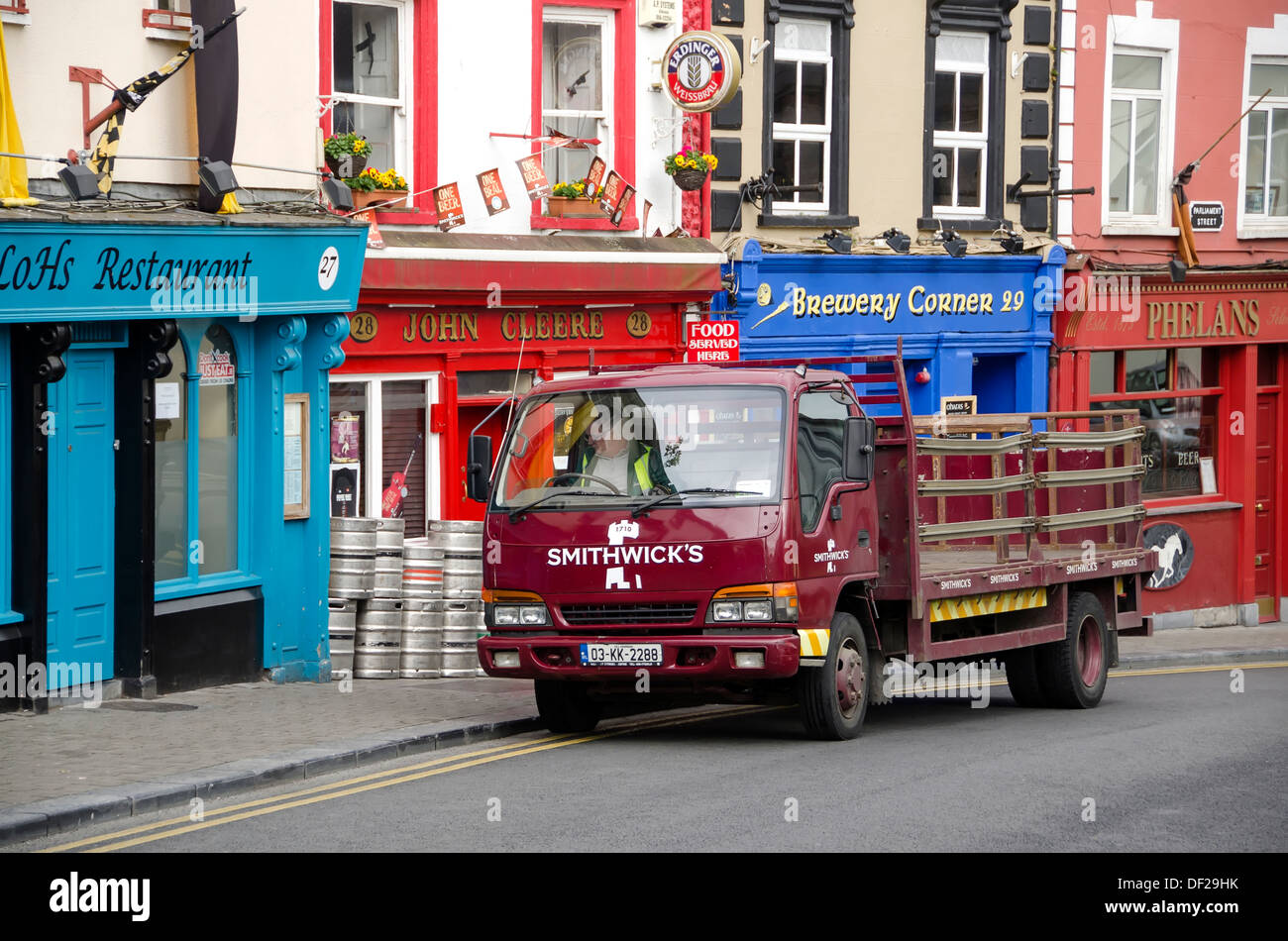 Smithwick's delivery truck in front of pubs in Kilkenny, home of Smithwick's brewery, Ireland. - Stock Image