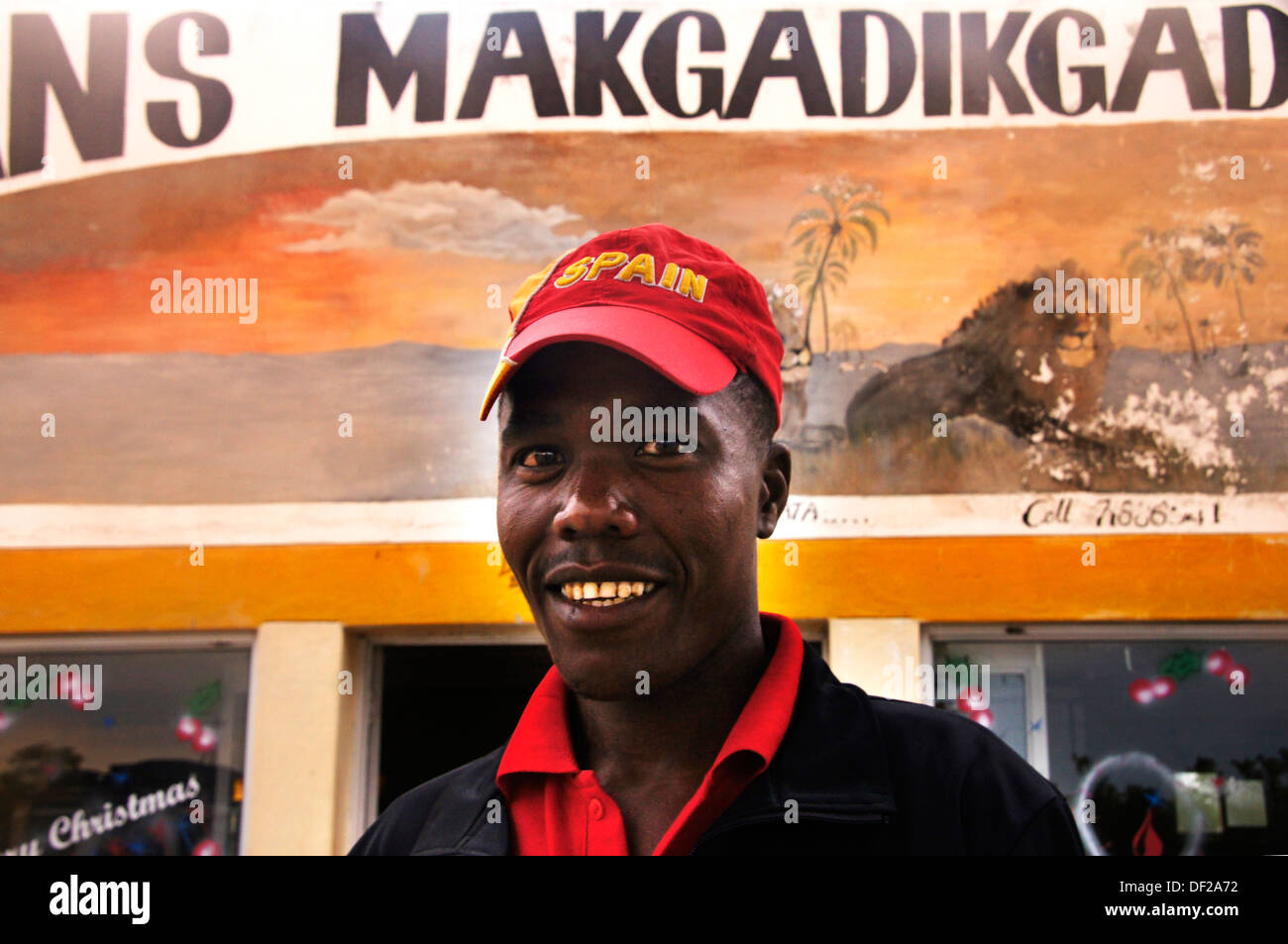 Man in a gas station with a cap of Spain (winner of the South Africa 2010 FIFA World Cup), Gweta, Botswana - Stock Image