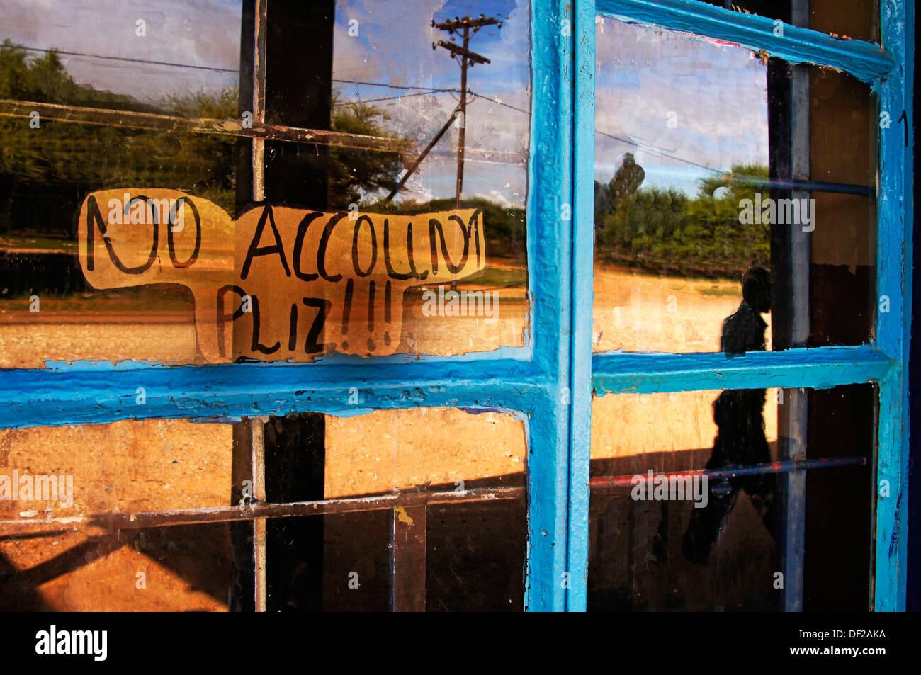 ´No Account Pliz!!!´ Please!!! on a window of a shop at D´Kar San bushman district area, Ghanzi Farms, Botswana - Stock Image
