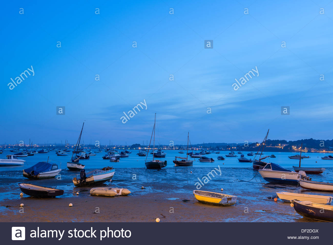 Boats in Sandbanks, Poole, Dorset, UK during the blue hour. - Stock Image