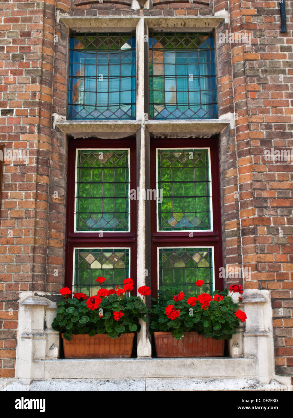 Traditional guilded house window, Bruges - Stock Image
