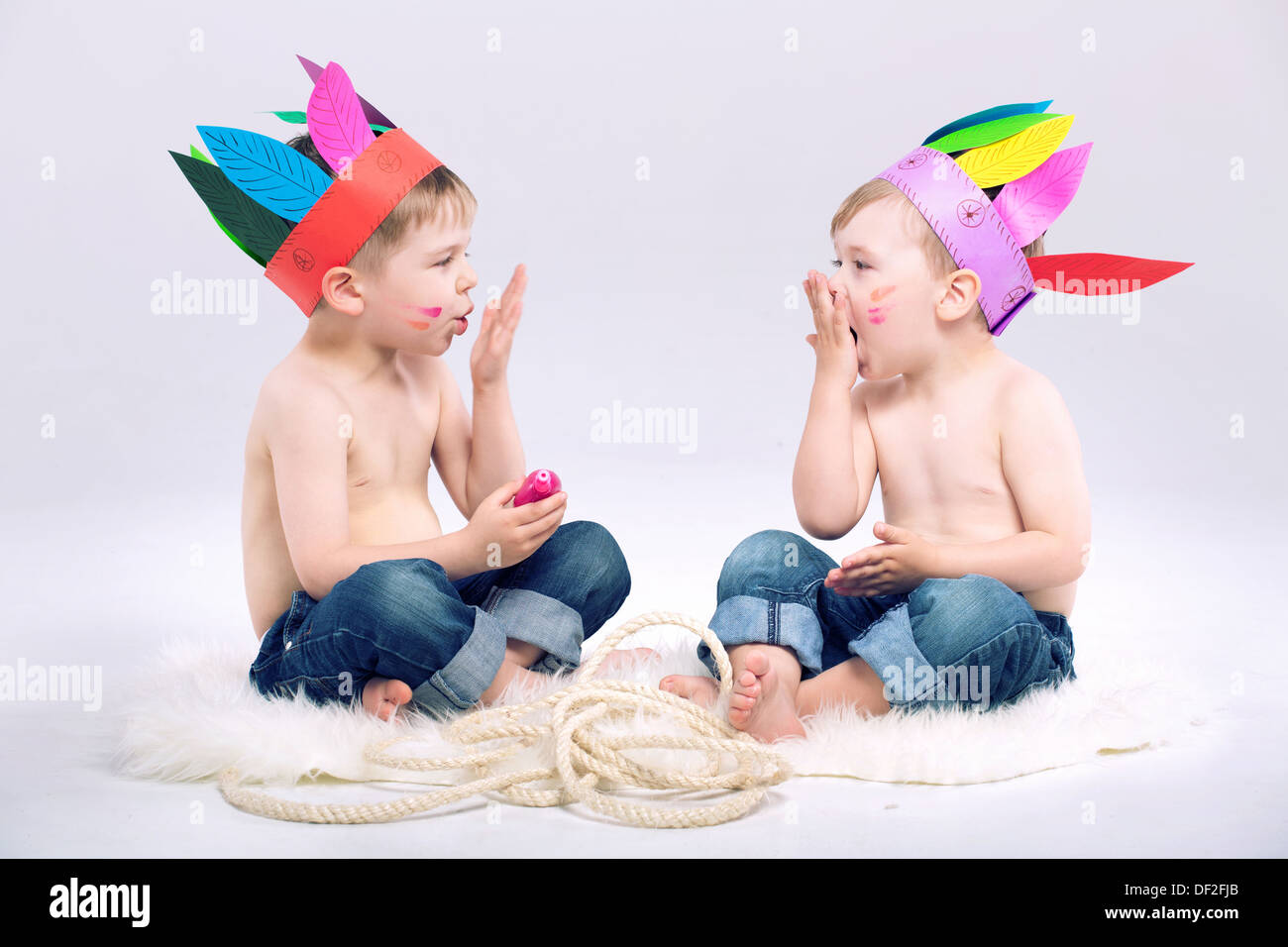 Young Indian boys with fancy colorful hats - Stock Image