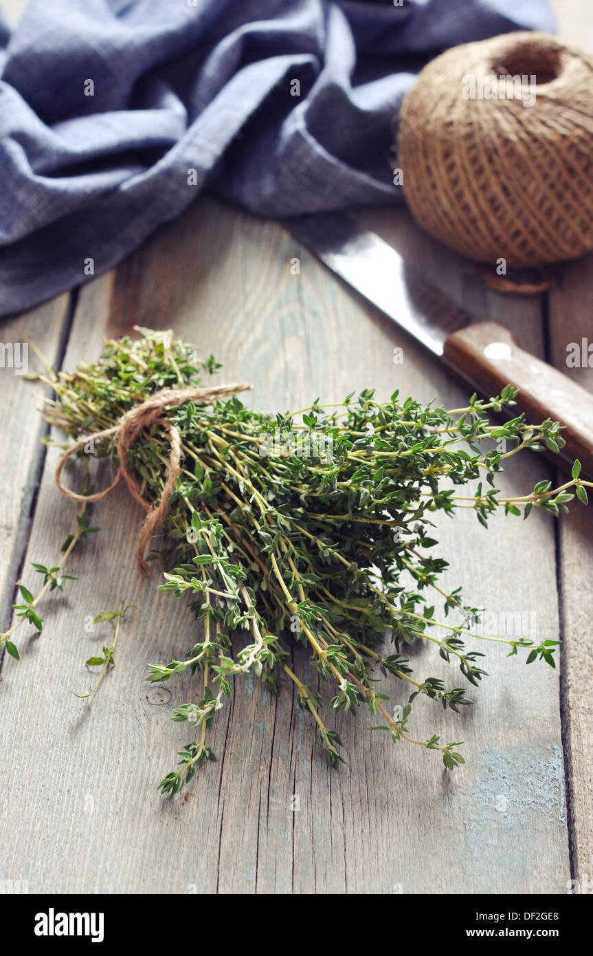 Bunch of fresh thyme on wooden background - Stock Image