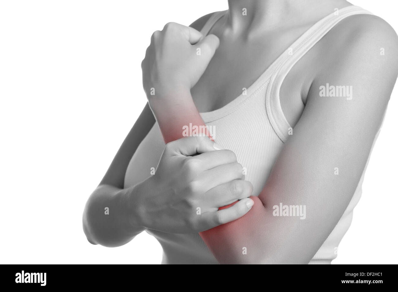 Female with pain in her forearm. Black and White with a red spot around the painful area. Isolated. - Stock Image