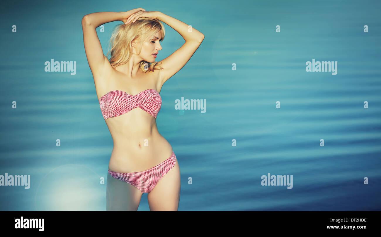 Cute blonde lady wearing nice swimsuit - Stock Image