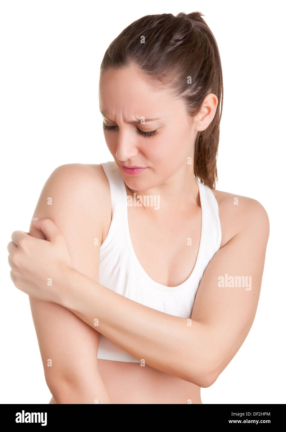 Female with pain in her arm, isolated in a white background - Stock Image