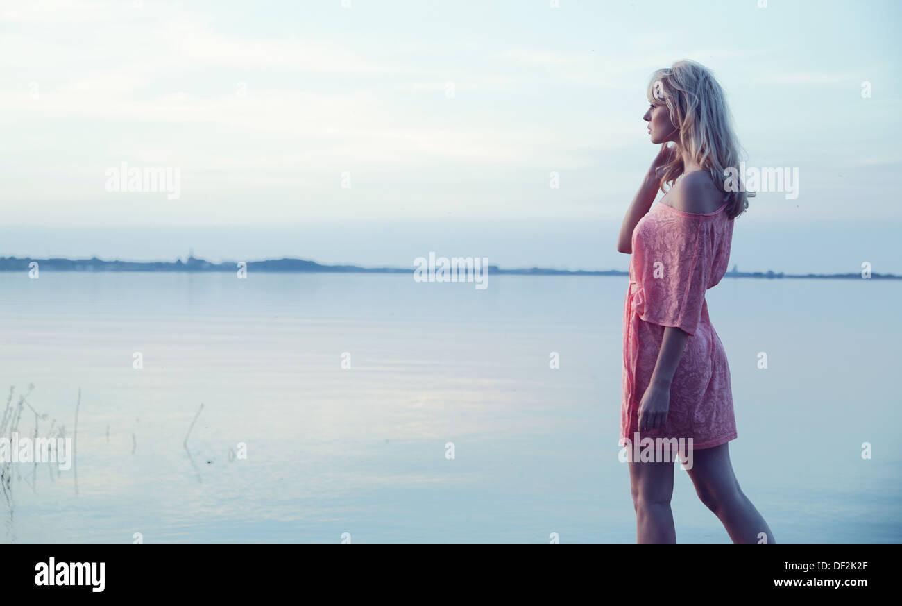 Delicate blonde lady wearing nice dress - Stock Image