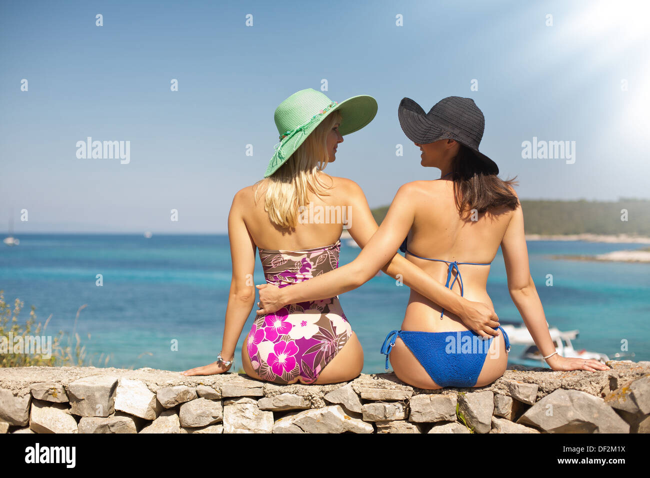Summer shapely ladies on the beach - Stock Image