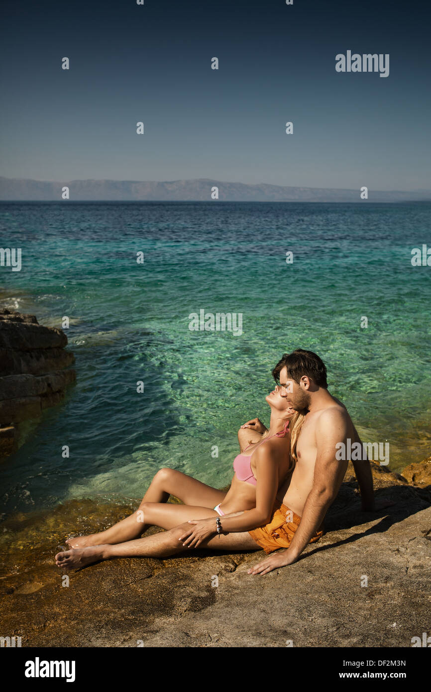 Young couple enjoying their spare time in tropical area - Stock Image