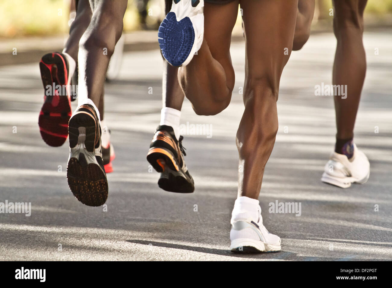 Legs Of A Group Street Marathon Runners