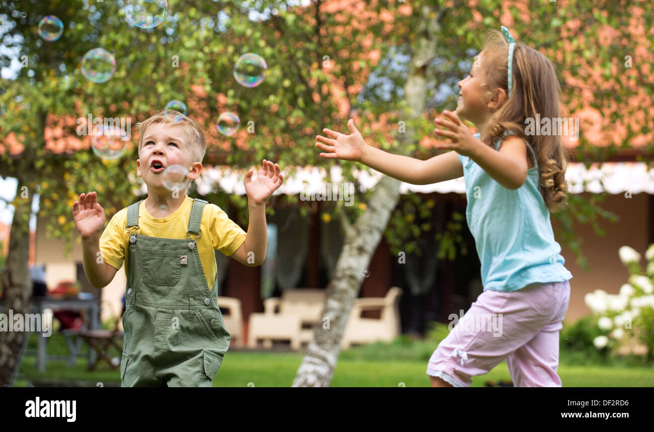 Children playing at the summer garden - Stock Image