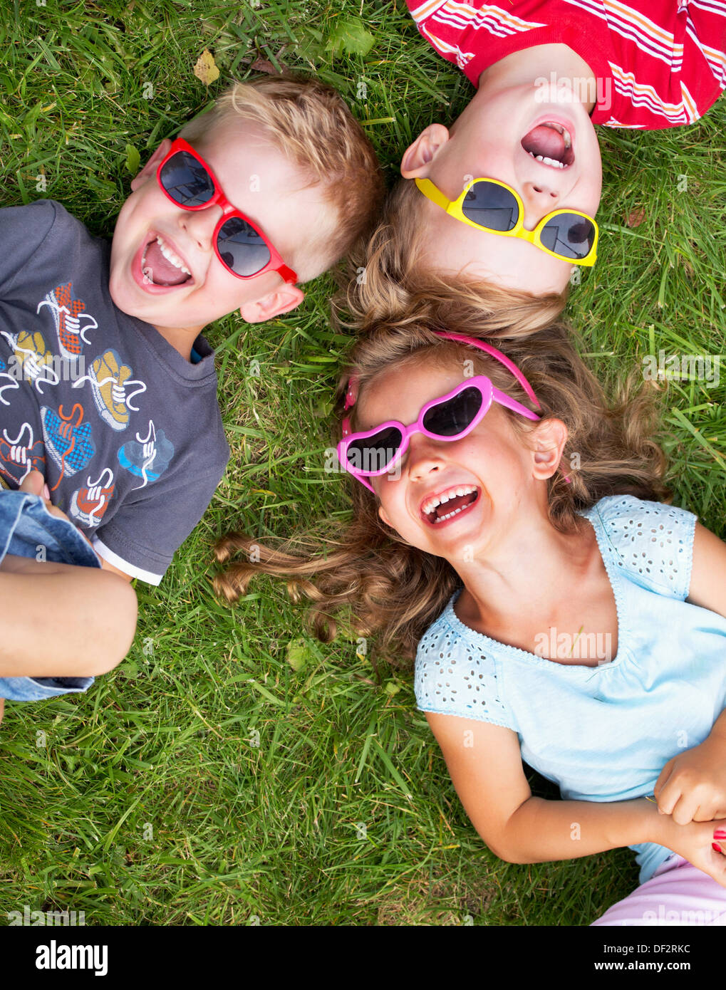 Laughing children relaxing during summer day - Stock Image