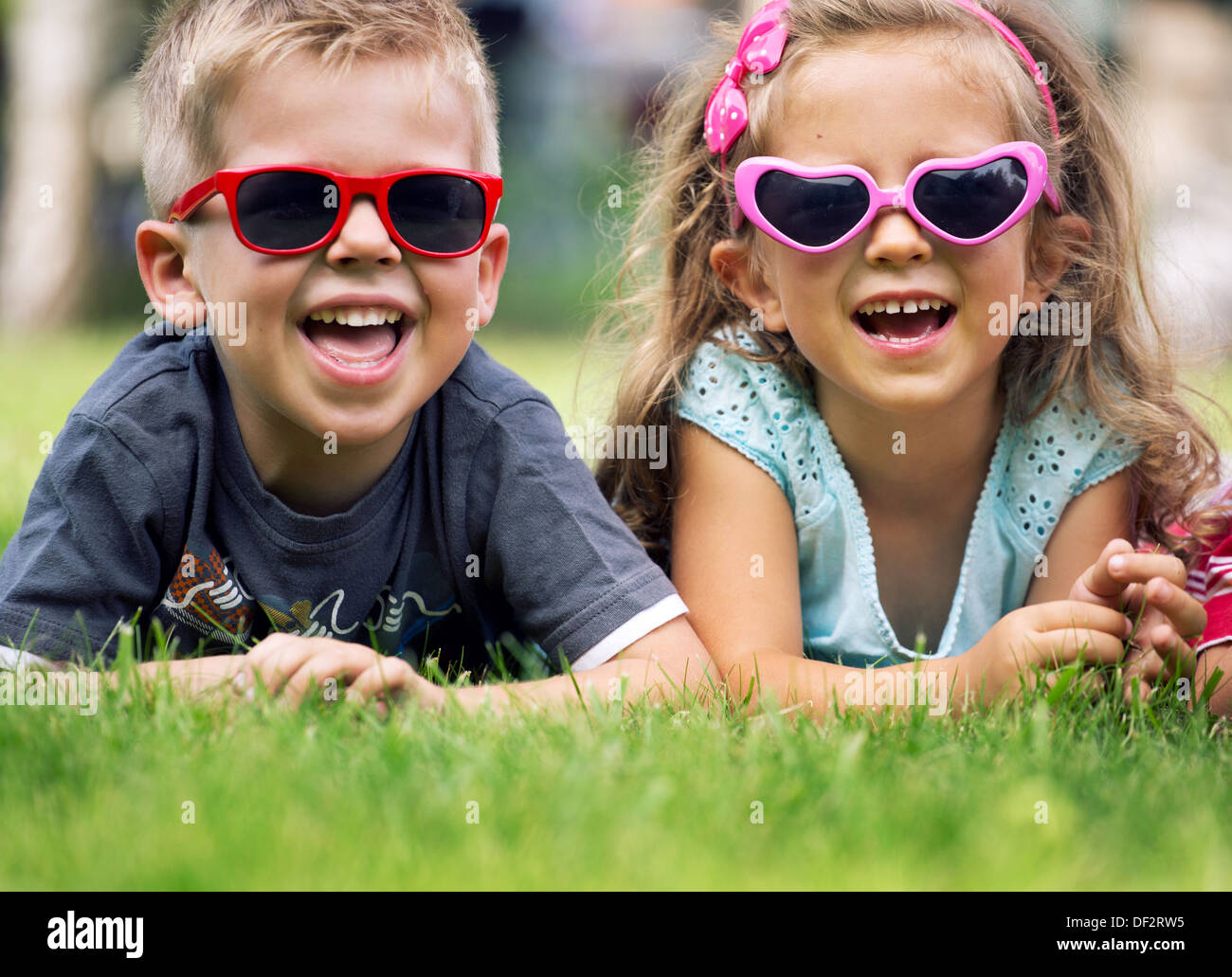 Cute small children with fancy sunglasses - Stock Image