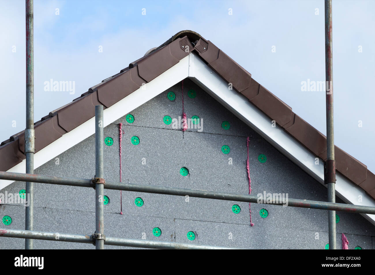 External foam insulation on council houses without cavity wall insulation in Billingham, England, UK - Stock Image