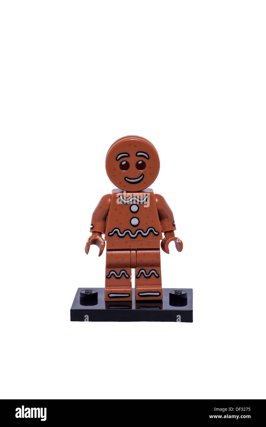 A Gingerbread man Lego minifigure on a white background - Stock Image