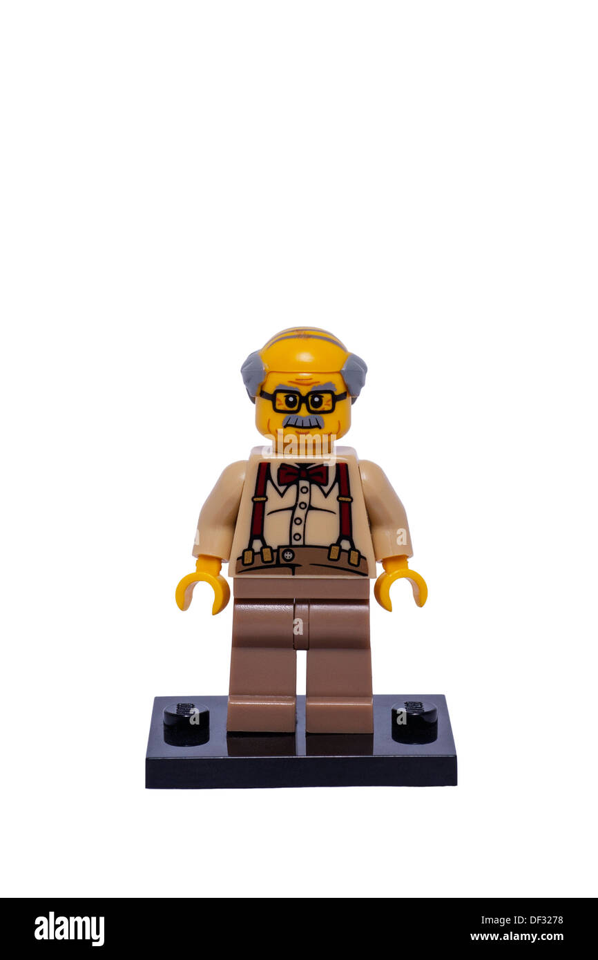 A Lego minifigure on a white background - Stock Image