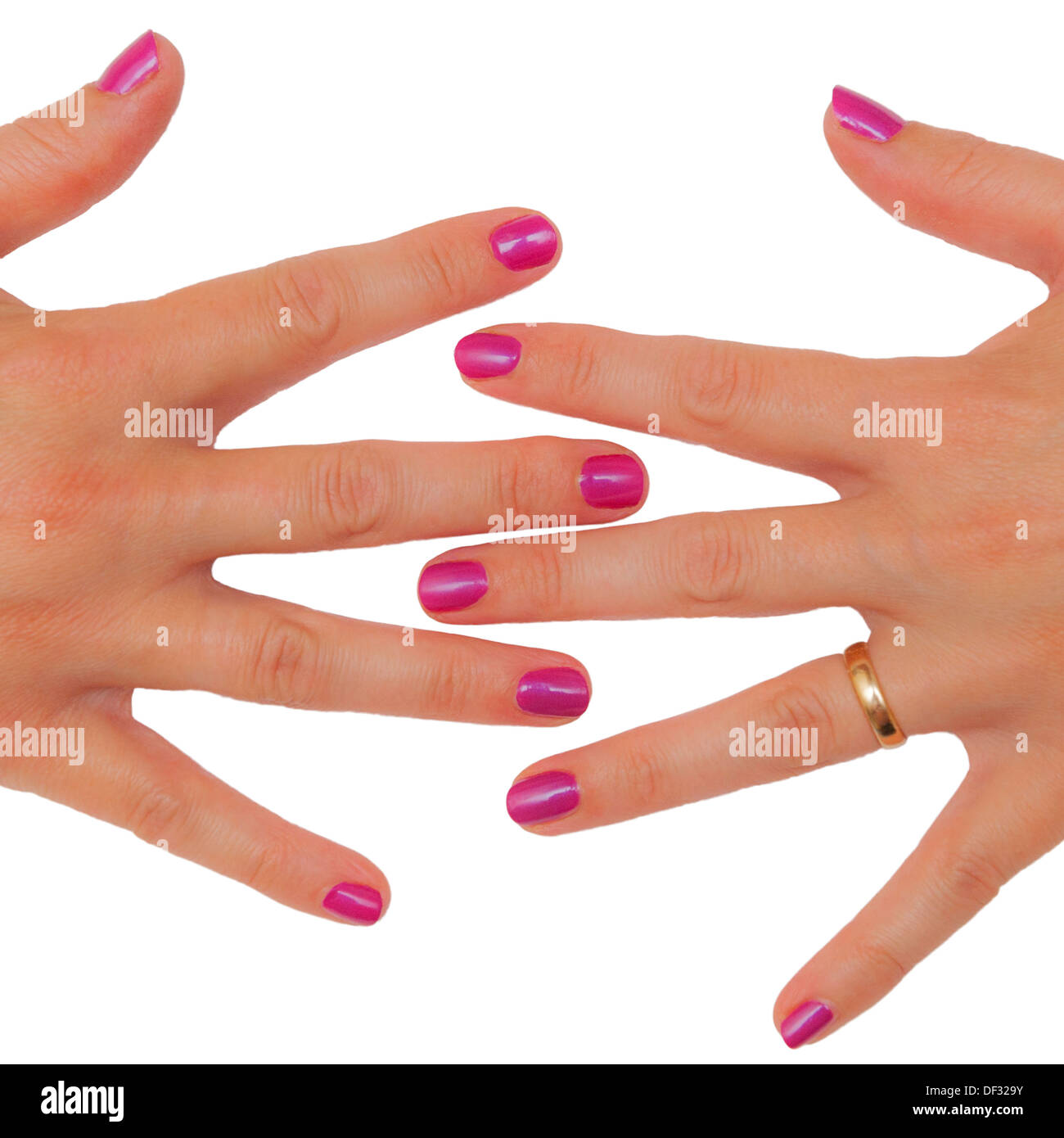 A womans hands freshly manicured with pink painted nails - Stock Image