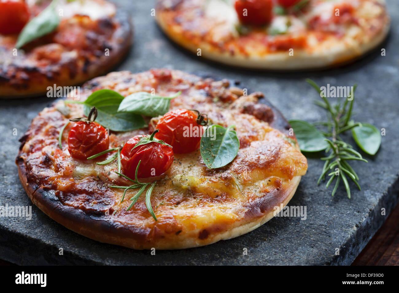mini pizzas - Stock Image