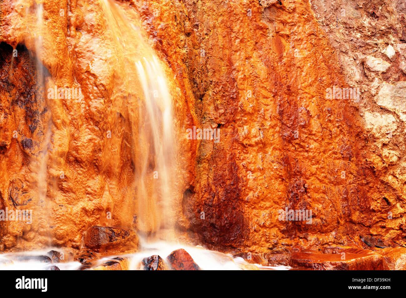 Stream of oxidized iron minerals. Río Tinto, Huelva province. Spain - Stock Image