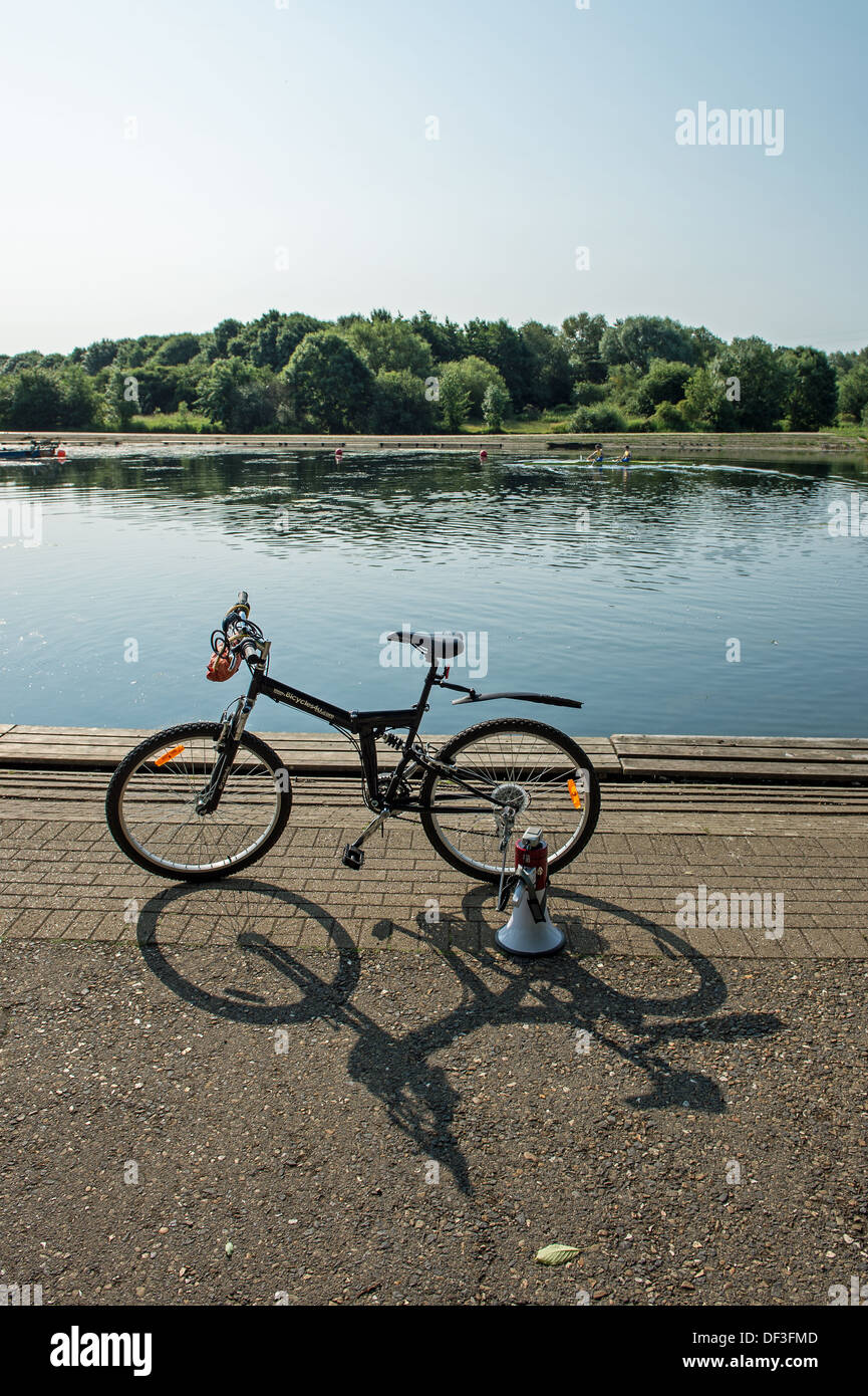 Rowing coaches' bike and megaphone. - Stock Image