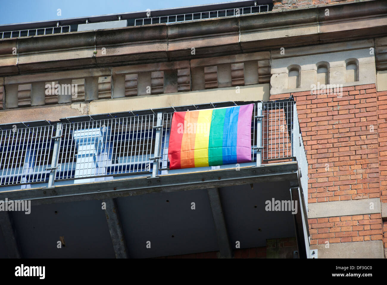 Rainbow flags fly over the Gay Village around Canal Street, Manchester, England. - Stock Image