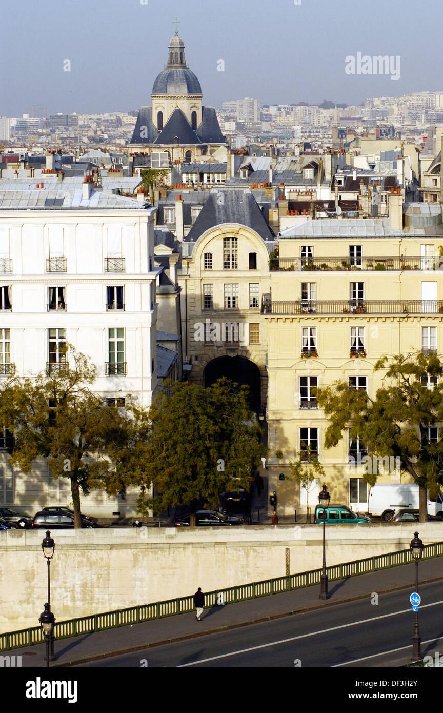 Aerial view of Pont de Sully, church of Saint-Louis en l´Île and rooftops. Paris. France - Stock Image