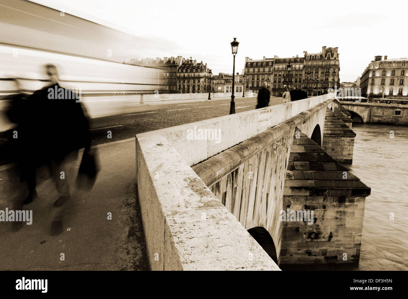 Passers-by on the Pont du Carrousel. Paris. France - Stock Image