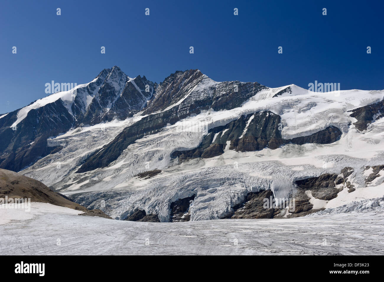 Austria / Hohe Tauern National Park - Impacts of climate change: Mount Grossglockner towering above melting Pasterze glacier. - Stock Image