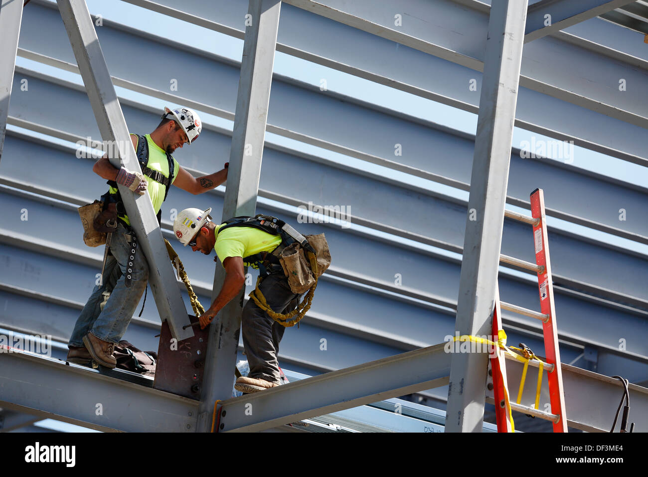 Iron workers construction site Stock Photo