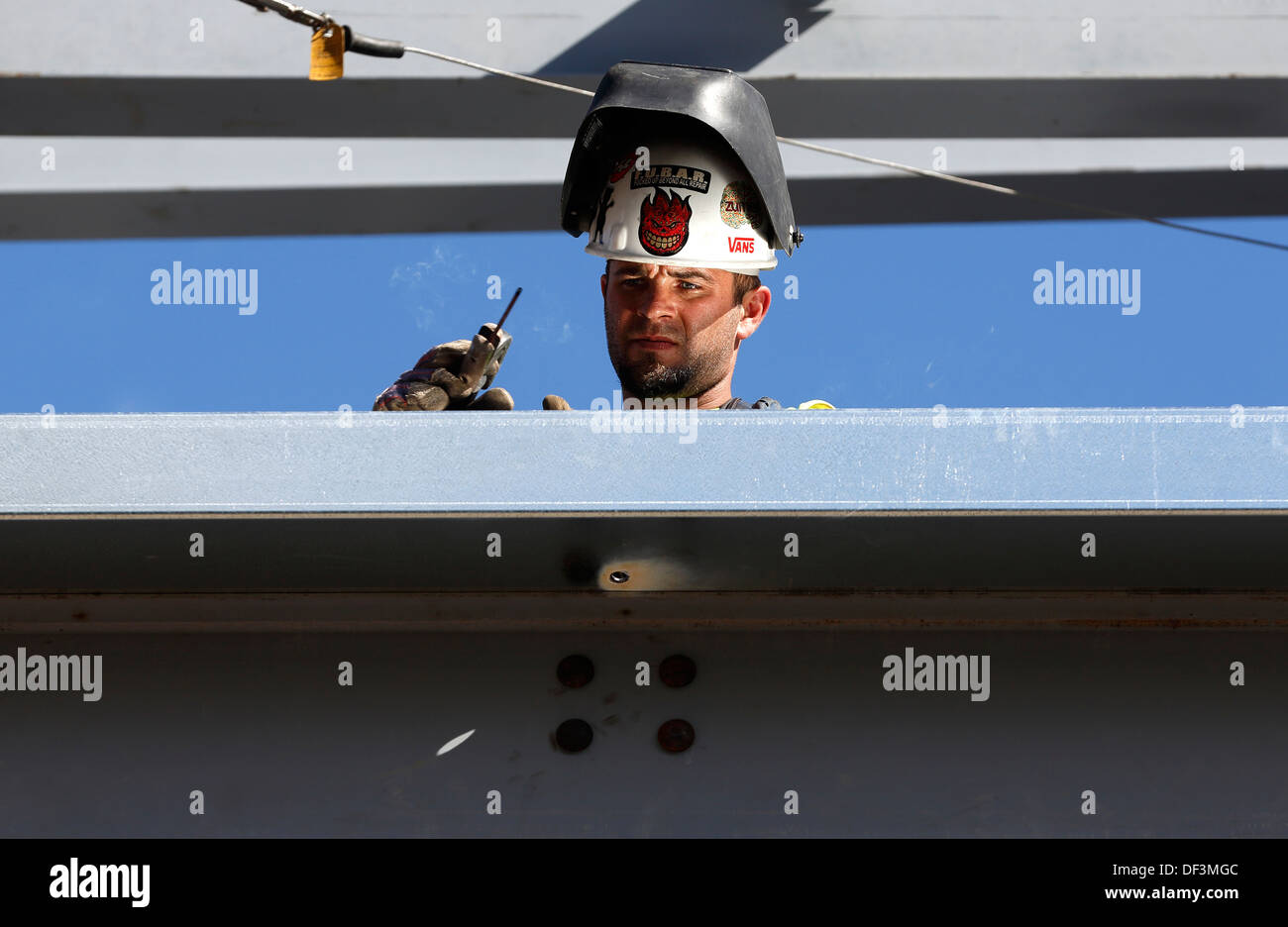 Iron worker welding on construction site Stock Photo