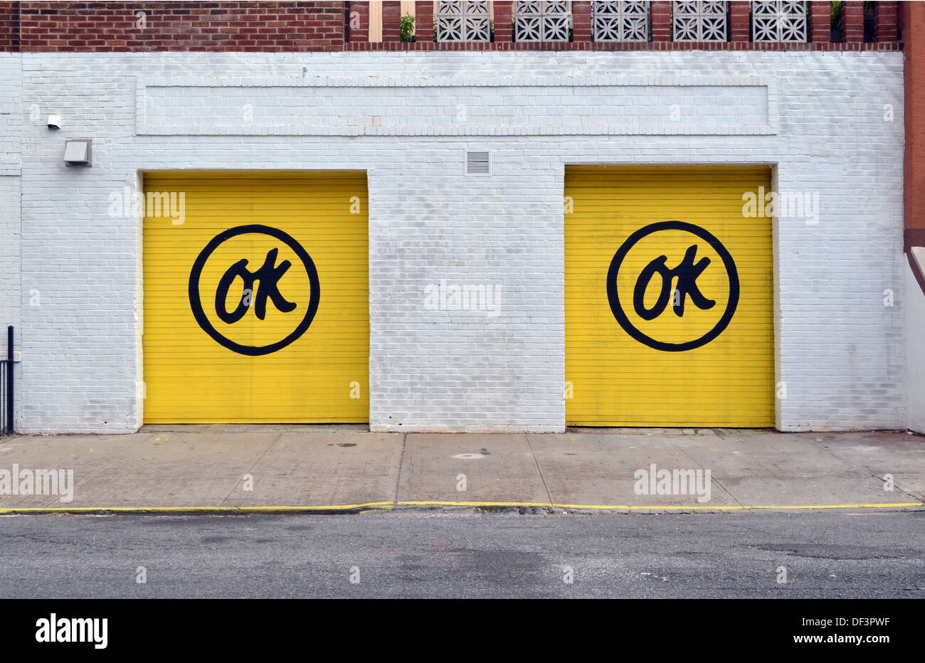 A Street Artists Work On Garage Doors On North 6th Street In Stock