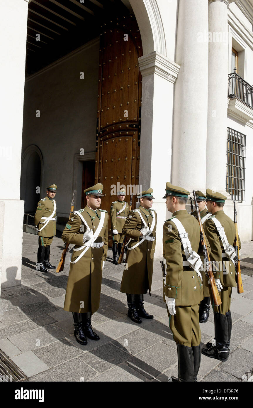 The Changing of the Guard. La Moneda Palace is considered a masterwork in the civil architecture of Colonial Latin America and - Stock Image