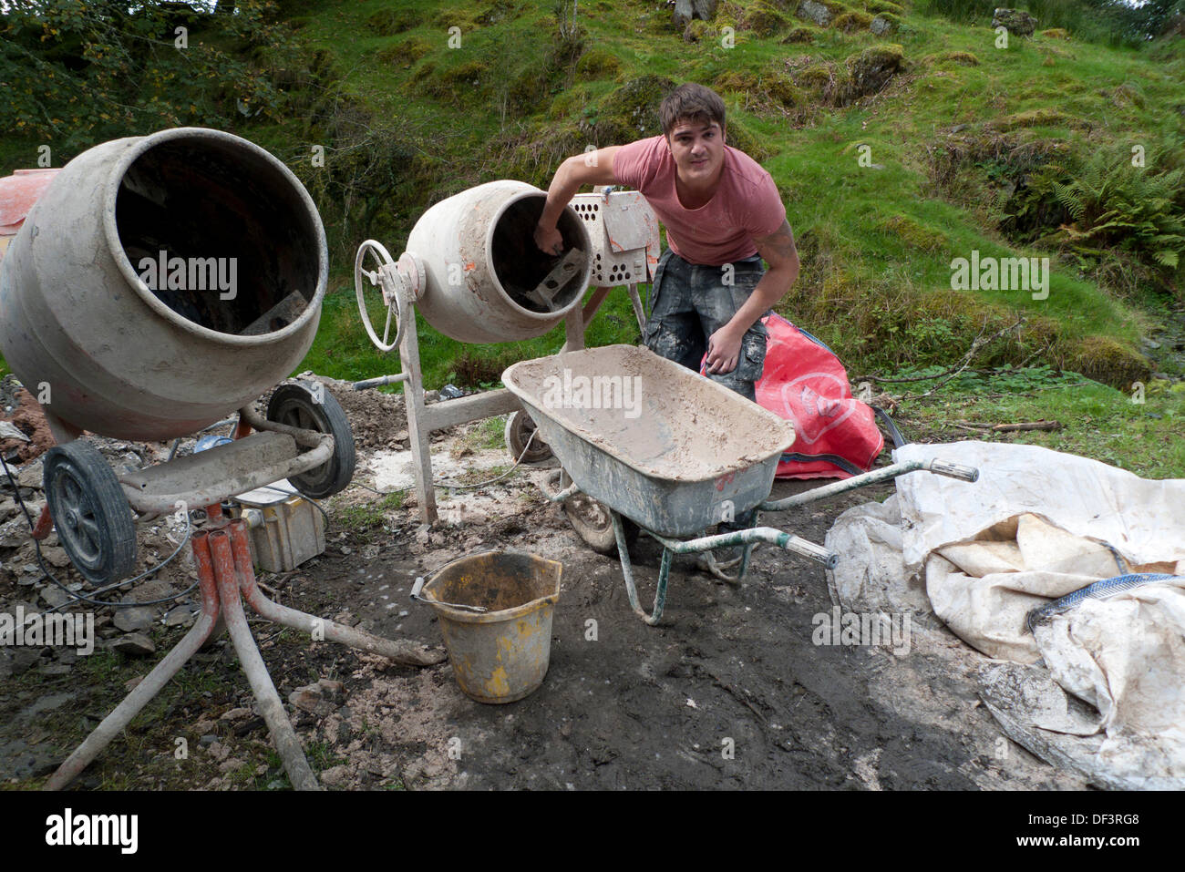 Llanwrda, Wales UK Fri 27th Sept 2013. 22 year old Carl Evans of Ammanford, a fully qualified plasterer, cleans Stock Photo