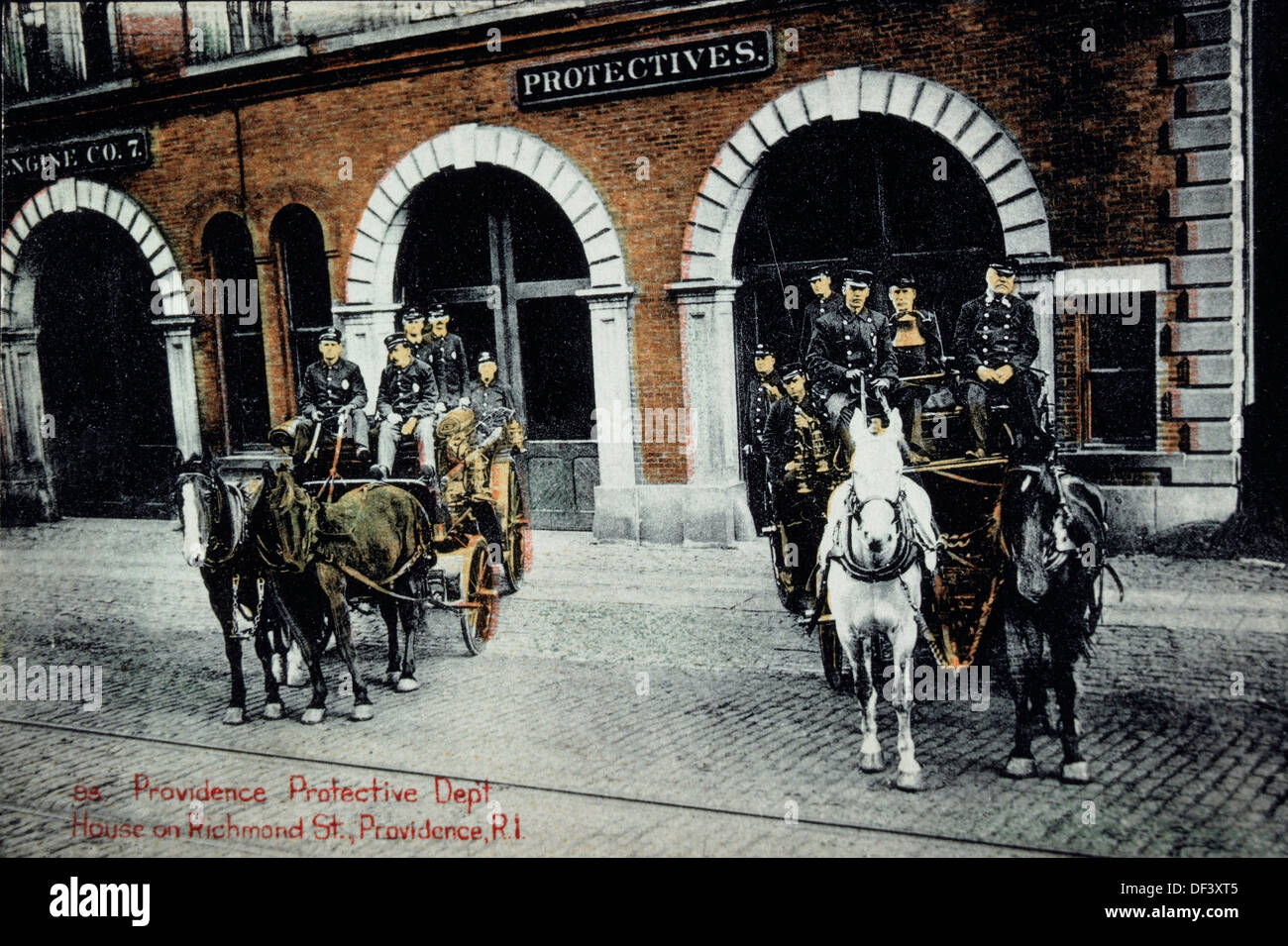 Firemen on Horse-Drawn Firetrucks in Front of Firehouse, Providence, Rhode Island, USA, Hand-Colored Photograph, 1902 - Stock Image