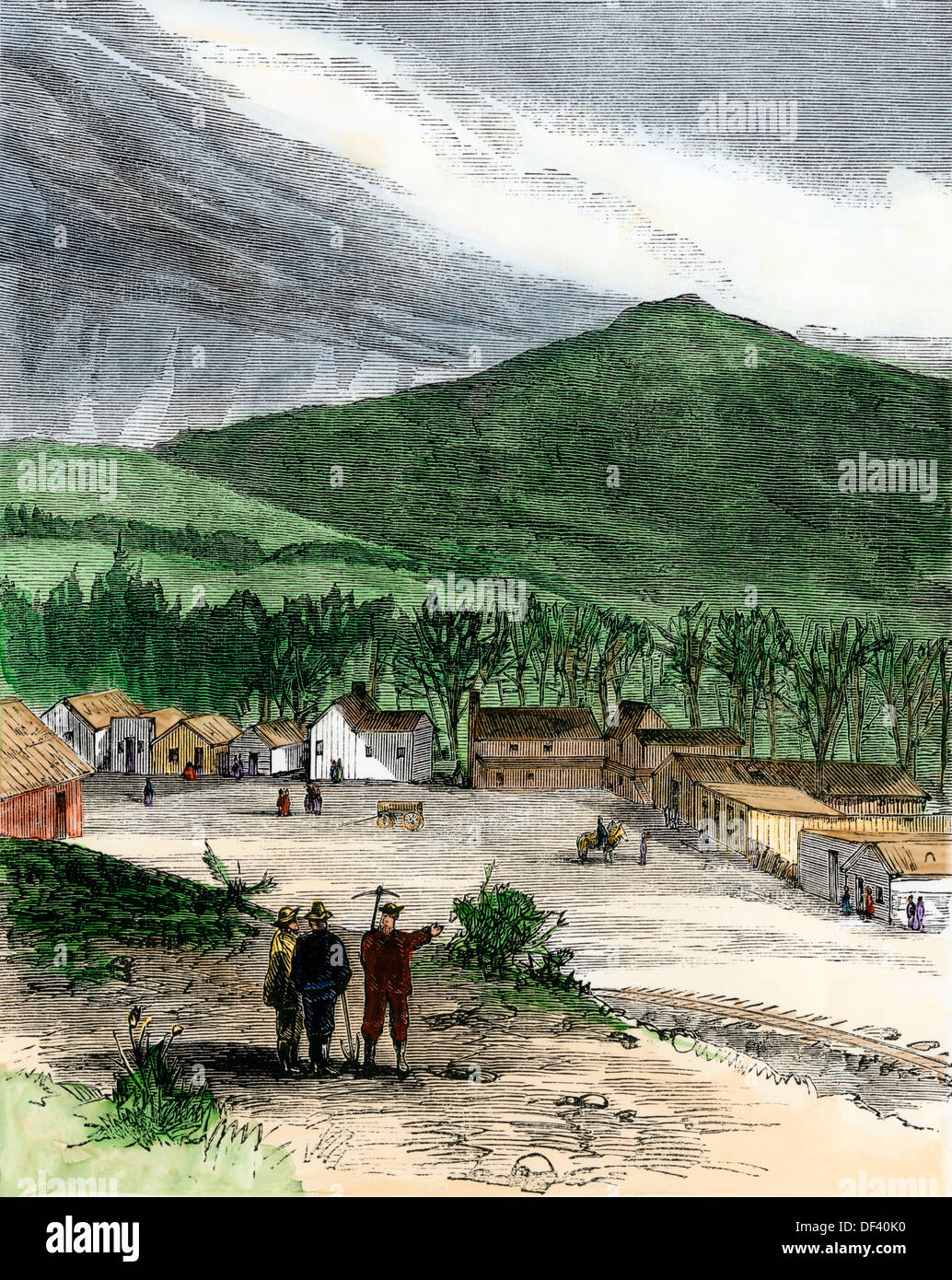 Transcontinental railroad workers' camp at Echo City, Utah, terminus of the Union Pacific RR, 1860s. Hand-colored woodcut - Stock Image