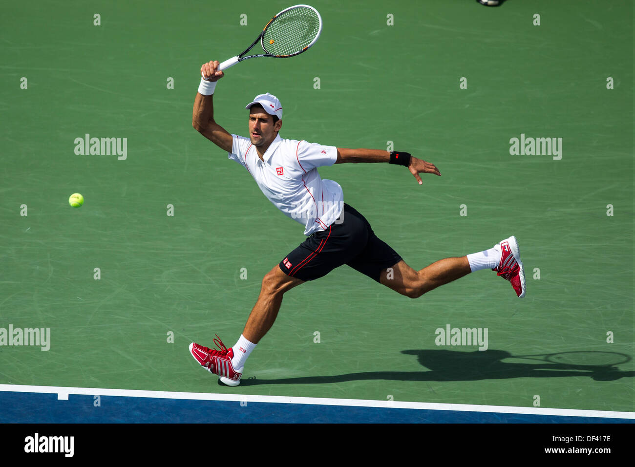 Novak Djokovic (SRB) competing in the Semifinals at the 2013 US Open Tennis Championships - Stock Image