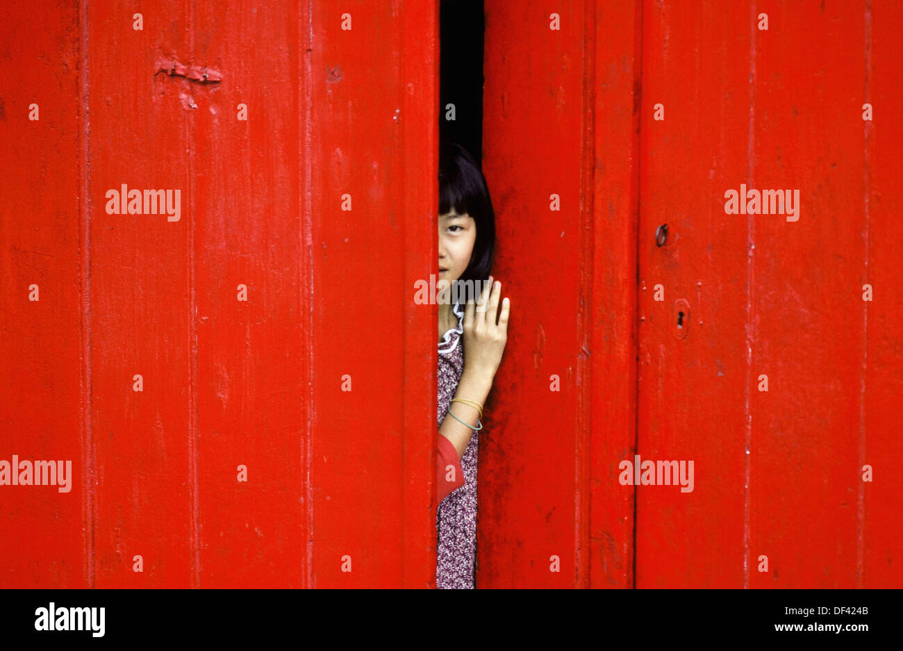 Chinese Girl Behind The Red Door Port Louis Mauricius Stock Photo