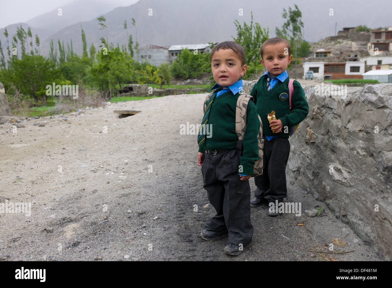 Primary school boys outside of the village of Chumarkhand, near Karimabad, Hunza Valley, Gilgit-Baltistan, Pakistan - Stock Image