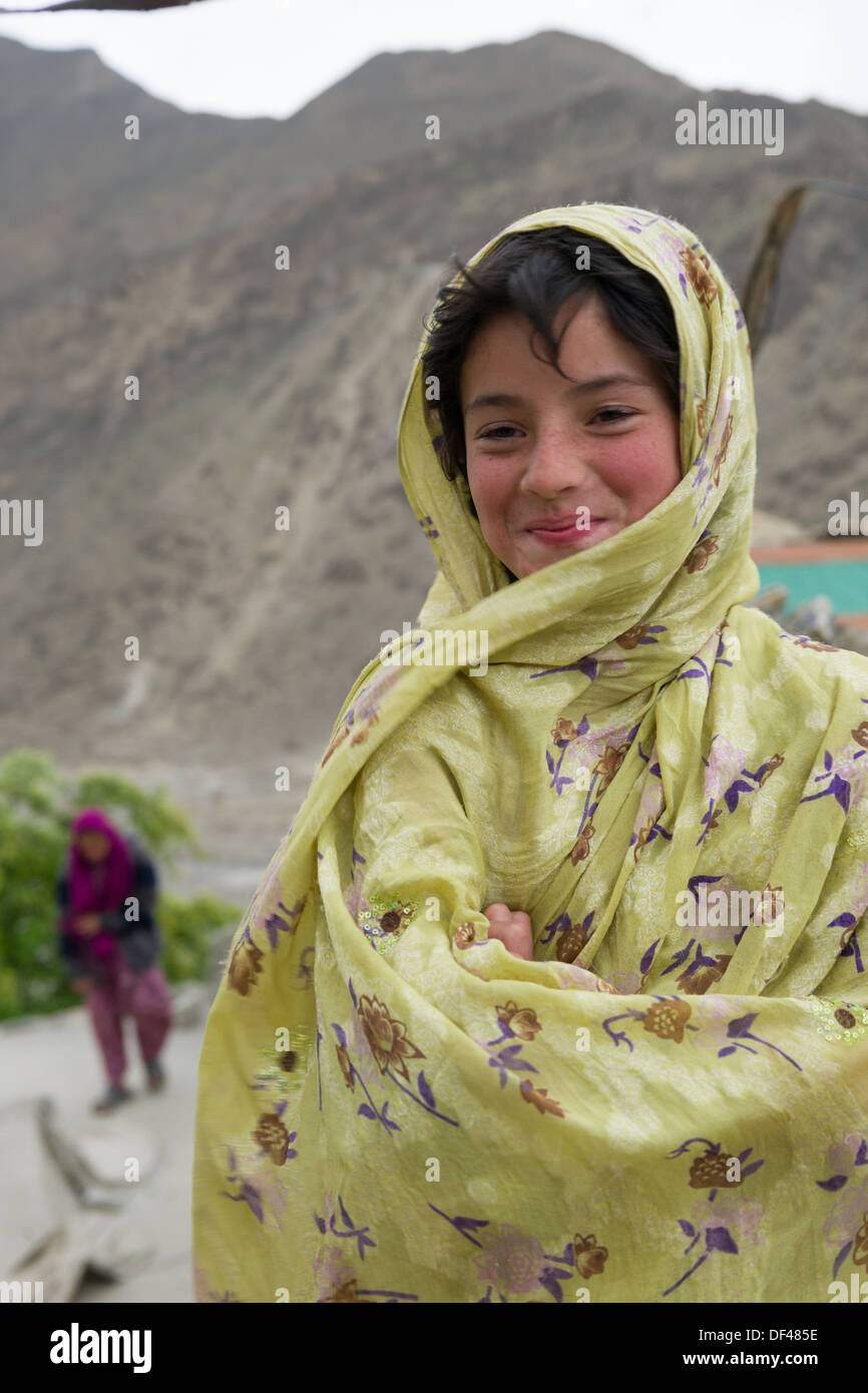 Young woman on a rooftop at Altit Village, near Karimabad, Hunza Valley, Gilgit-Baltistan, Pakistan - Stock Image