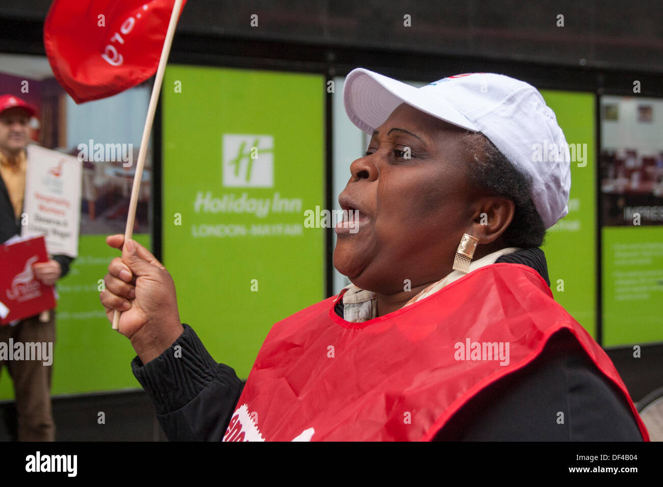London, UK. 27th Sep, 2013.  Unite The Union demonstrates on World Tourism Day outside the Radisson May Fair hotel and the Holiday Inn in Mayfair demanding that the hotel groups pay the London Living Wage of £8.55 per hour to their lowest paid workers. Credit:  Paul Davey/Alamy Live News - Stock Image