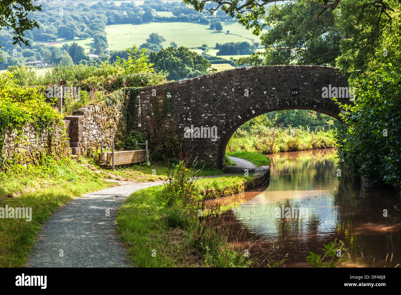 Stone bridge over the Monmouthshire and Brecon Canal at Llangynidr in the Brecon Beacons National Park. - Stock Image