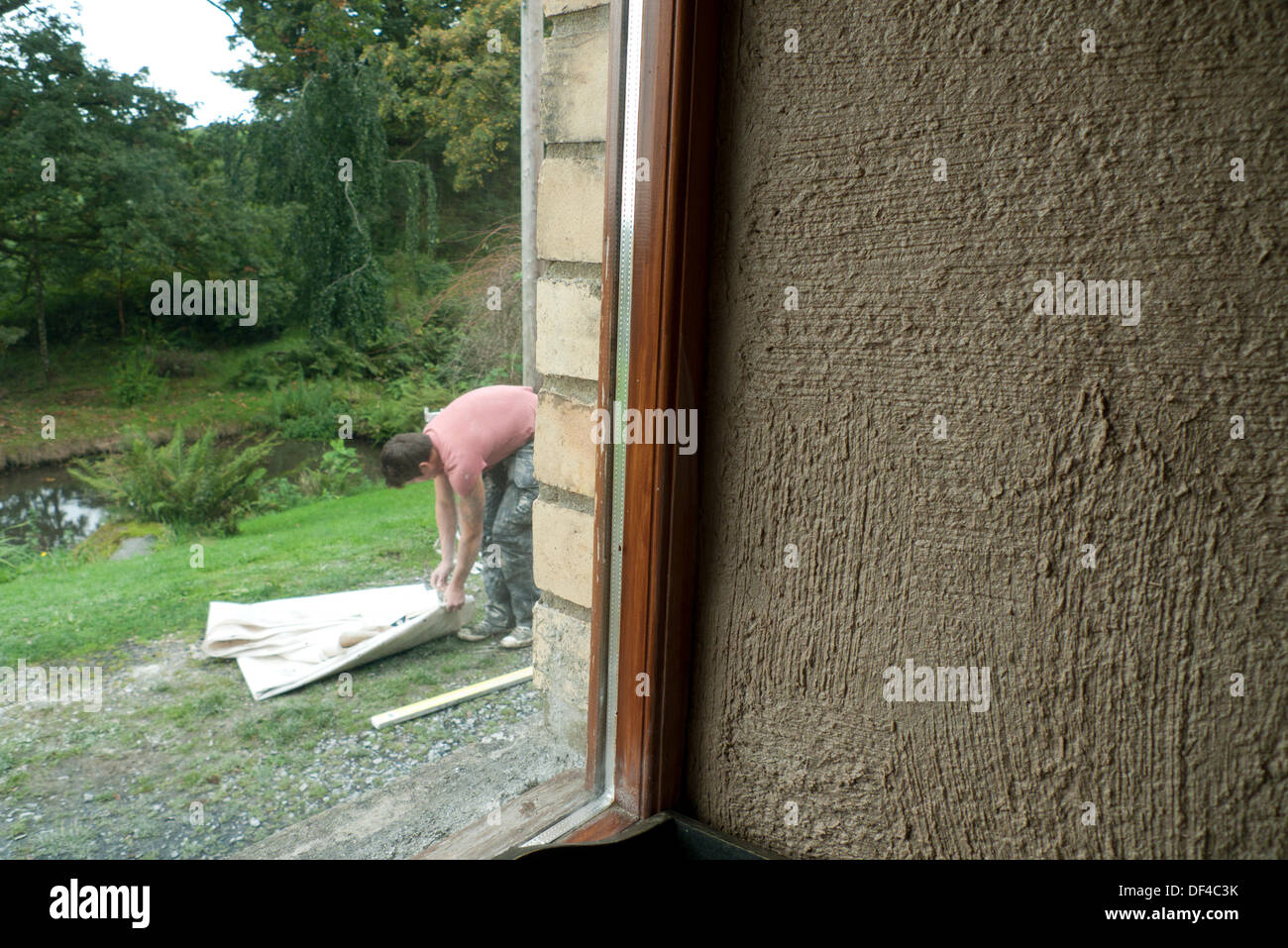 Llanwrda, Wales UK Fri 27th Sept 2013. Close-up detail of the first thick layer of lime hemp plaster on an interior Stock Photo