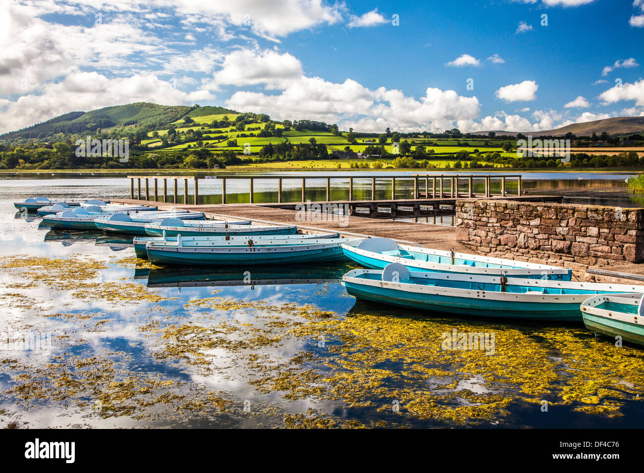 Rowing boats moored at Llangors Lake in the Brecon Beacons National Park, Wales. - Stock Image