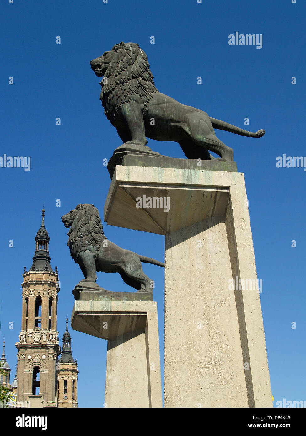 Bronze lions towering over the Basilica of Our Lady of The Pillar,Zaragoza,Spain - Stock Image