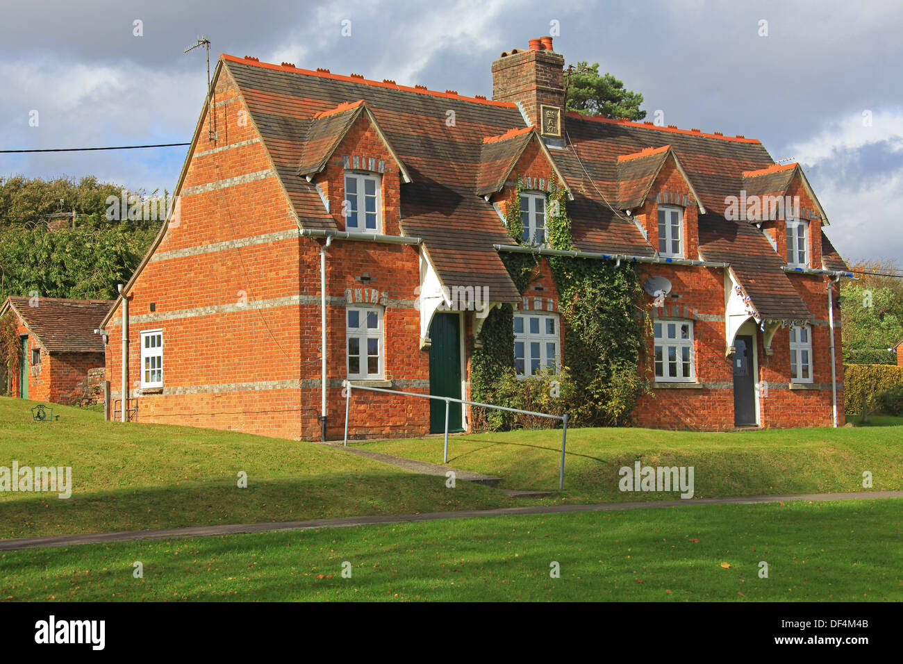 A pair of very neat 'Alms' houses built in 1870 in a well maintained rural setting. - Stock Image